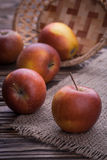 Red apples on wooden table, selective focus Stock Image