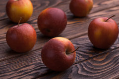 Red apples on wooden table, selective focus Stock Photography