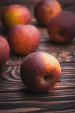 Red apples on wooden table, selective focus Royalty Free Stock Image