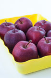 Red apples in the yellow tray. Royalty Free Stock Photo