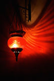 Red arabian lamp. With shadows on dark wall Stock Photography