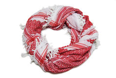 Red arabic scarf isolated on white background. The red arabic scarf isolated on white background Royalty Free Stock Photography