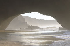 Red arch on atlantic ocean coast in Morocco Stock Photos