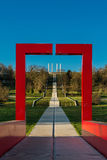 A red arch framing the columns of the major axis against a backg. The monumental work of Dani Karavan in Cergy, France Royalty Free Stock Images