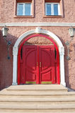Red arched door Stock Photography