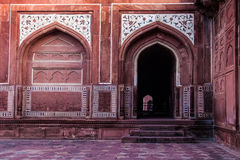 Red Arches and Arched Doorways with Marble Inlay Designs. On Either side of Taj Mahal Lie these Buildings of Red Sandstone with Arches, Arched Doorways and Royalty Free Stock Images