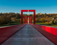 The red arches of the bridge over blue sky background Stock Image