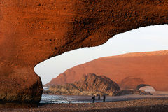 Red archs on atlantic ocean coast. Morocco Stock Images