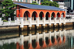 Red archway by the river Royalty Free Stock Photography