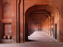 Red Archways in Mosque. Red sandstone archways in Jami Masjid Mosque, Fatehpur Sikri, India Royalty Free Stock Image