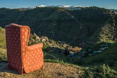 Red arm chair perched on hillside,Sacromonte caves,Granada,Andalucia,Spain royalty free stock photos