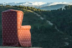 Red arm chair perched on hillside,Sacromonte caves,Granada,Andalucia,Spain royalty free stock photography