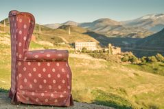 Red arm chair perched on hillside,Sacromonte caves,Granada,Andalucia,Spain royalty free stock images
