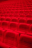 Red arm-chairs in empty hall Stock Photos