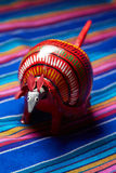 Red armadillo. Mexican handmade toy of a red armadillo over a blue backdrop Royalty Free Stock Photos