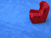 Red armchair. Blue stage with red armchair in a department store Stock Photography