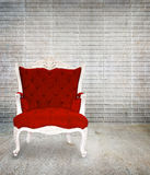 Red armchair classical style in grunge Stock Photography