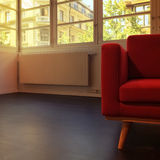 Red armchair in empty room Royalty Free Stock Image