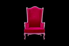 Red armchair isolated on black background Royalty Free Stock Images
