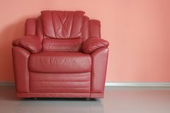 Red armchair in red room Royalty Free Stock Photo