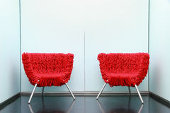 Red armchair in waiting room Royalty Free Stock Images