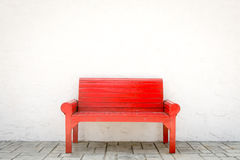 Red armchair a white wall and grey floor Royalty Free Stock Image