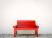 Red armchair a white wall and grey floor Stock Photos