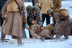 Red Army medics in action with the injured soldier. Royalty Free Stock Photography
