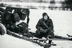 Red Army soldier is sitting on the 76-mm divisional gun M1942 ZiS-3. Royalty Free Stock Image