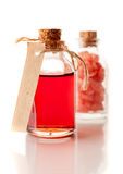 Red aromatherapy essential oil and sea salt Royalty Free Stock Image