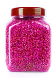 Red aromatic bath salt in bottle Stock Photography