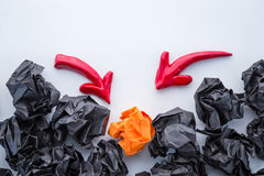 Red arrow aim to orange crumpled paper stock photos