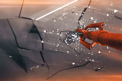 Red arrow breaking glass closeup Stock Photography
