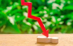 The red arrow cleaves the person. Victim of the economic crisis, falling quotations and the collapse of the market. Vulnerable per. Son, defeat and loss. The stock photography