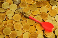 Red arrow dart board on Gold coin money for business success stock photos