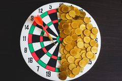 Red arrow dart board on Gold coin money for business success stock photo