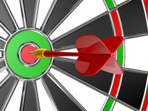 Red Arrow with Dart Board. Red plastic arrow in the center of dart board Royalty Free Stock Photography
