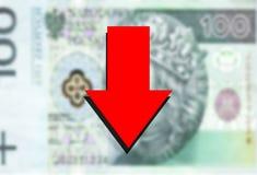 Red arrow down on polish money background Stock Photos