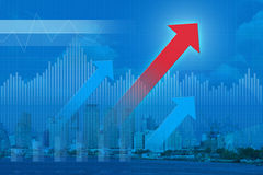 Red arrow with Financial graph on city; success concept. Red arrow head with Financial graph on city; success concept Royalty Free Stock Photo