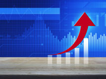 Red arrow with graph on wooden table over financial graph. And chart, Success business concept Royalty Free Stock Photo