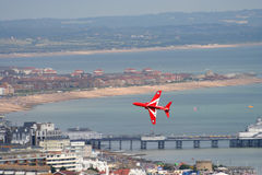 Red arrow jet. Red arrow aerobatic flying display team Performing at Eastbourne airshow Sussex England Royalty Free Stock Photography