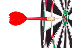 Red Arrow in the Middle of Dart Board Stock Image