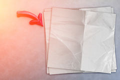Red arrow with paper note on grey background Royalty Free Stock Photos