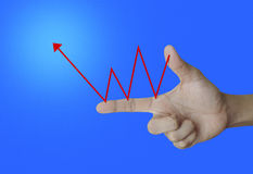 Red arrow representing growth on the hand, success concept Royalty Free Stock Photography