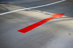Red arrow on road Stock Photo