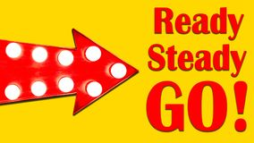 Ready, Steady, Go! red arrow shaped vintage colorful illuminated metallic display direction sign with glowing light bulbs. Red arrow shaped vintage colorful stock photos