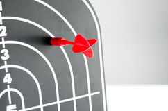 Red arrow shooting at heart position of profile shape black dart Royalty Free Stock Photography