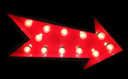Arrow Sign. Red Arrow Sign with Tivoli Lights on Black Background royalty free stock photography