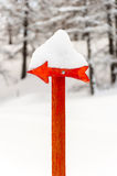 Red arrow signal with snow Royalty Free Stock Photography