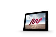 Red arrow on tablet screen Stock Photo